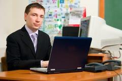 Hommes avec l'ordinateur portatif Images libres de droits