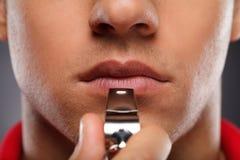 Hommes avec le sifflement Photo stock