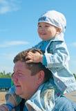 Hommes avec un petit garçon Images stock