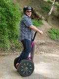 Hommes ayant l'amusement sur segway Photos libres de droits