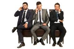Hommes d'affaires aux téléphones Images stock