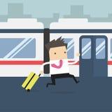 Hommes d'affaires courant et manqués le train Photos stock