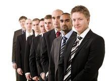 Hommes d'affaires dans une ligne Image libre de droits