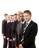 Hommes d'affaires dans une ligne Photos stock