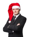 Hommes d'affaires de Santa dans le costume avec les bras croisés Images stock