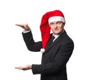 Hommes d'affaires de Santa dans le costume montrant le fond vide Image libre de droits