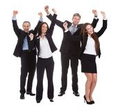 Hommes d'affaires heureux sautant dans la joie Photographie stock