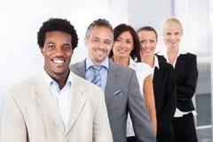 Hommes d'affaires multiraciaux heureux images libres de droits