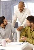 Hommes d'affaires sur un contact Photographie stock libre de droits