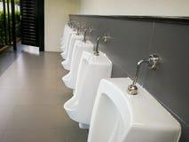 Hommes d'urinoirs Image libre de droits