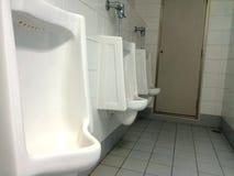 Hommes d'urinoirs Photographie stock libre de droits