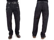 Hommes dans des pantalons de jeans Image libre de droits
