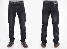 Hommes dans des pantalons de jeans Photos stock