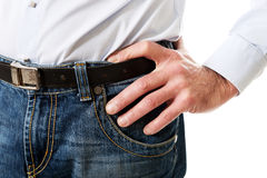 Hommes dans des pantalons de jeans Photographie stock libre de droits