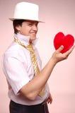 Hommes dans le capuchon blanc avec la relation étroite et le coeur. Photo stock