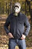Hommes dans le masque de gaz Photos stock