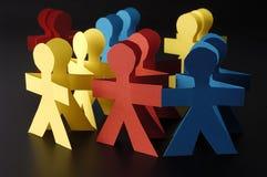Hommes de papier bleus et jaunes rouges Image stock