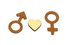 Hommes et femelle avec le symbole abstrait d'amour fait de cuir d'isolement sur le fond blanc Photographie stock libre de droits