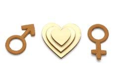 Hommes et femelle avec le symbole abstrait d'amour fait de cuir d'isolement sur le fond blanc Photo libre de droits