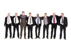 Hommes heureux dans une ligne Image stock