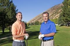 Hommes jouant au golf Photo libre de droits