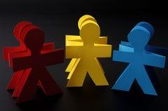 Hommes rouges de papier jaune et bleu Image libre de droits