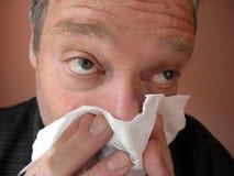 Hommes soufflant son nez #1 Photo libre de droits
