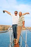 Hommes sur le bateau Photographie stock