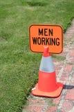 Hommes travaillant le signe Images libres de droits