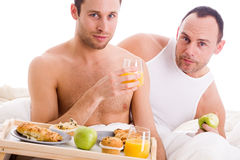 Homo couple enjoy their breakfast Stock Image