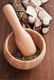 Homoeopathic Pharmacy. Mortar and pestle, glass small bottles Stock Photo