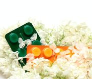 Homoeopathic pills and flowers Royalty Free Stock Photos