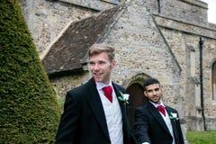Homoseksualny ślub, fornale opuszcza wioska kościół po poślubiającego z dużymi uśmiechami i trzymający rękę Obraz Stock