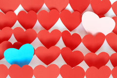 Homosexual Concept. Homosexual couple concept. One blue heart and one pink heart among multitude of red hearts royalty free stock photo