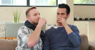 Homosexual couple drinking champagne stock video