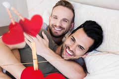 Homosexual couple embracing each other in bedroom at home Royalty Free Stock Photo