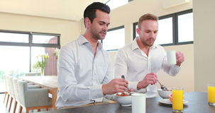 Homosexual couple having breakfast. In the kitchen stock footage