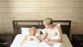 Homosexual couple lying on the bed stock video