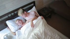 Homosexual couple lying on the bed stock video footage