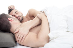 A homosexual couple onder a bed in studio white Stock Image
