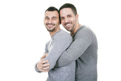A homosexual couple over a white background. On studio royalty free stock images