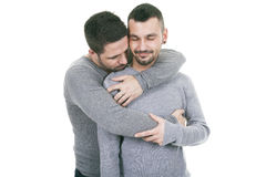 A homosexual couple over a white background Royalty Free Stock Photography