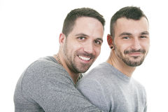 A homosexual couple over a white background. On studio royalty free stock image