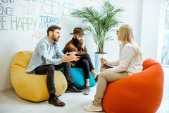 Homosexual couple during the psychological counseling. With female psychologist in the modern office stock photos