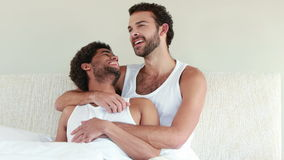 Homosexual couple speaking together on bed stock video footage