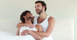 Homosexual couple speaking together on bed stock footage