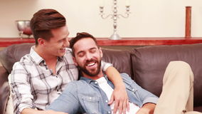 Homosexual couple together on the sofa. Homosexual couple on the sofa in the living room stock video