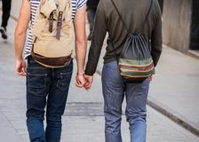 Homosexual couple walks hand in hand royalty free stock photos