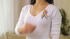 Woman with gay or lgbt pride awareness ribbon stock video footage
