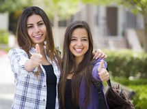 Homosexual Mixed Race Female Couple on School Campus With Thumbs Up Royalty Free Stock Images